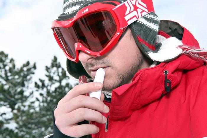 Snowboarder Applying Chapstick