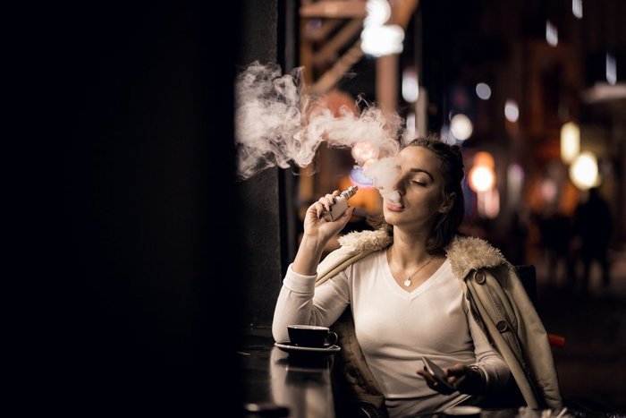 Woman Vaping in Public