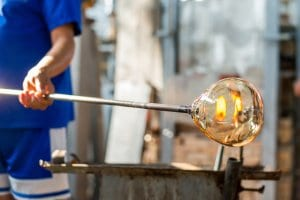 Man Turning Glasswork in Fire