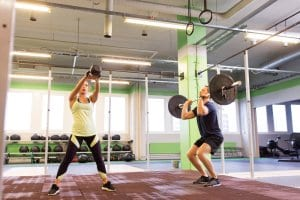Man and Woman Weightlifting