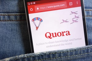 Quora app on a phone in a pocket -- Piotr Swat / Shutterstock.com