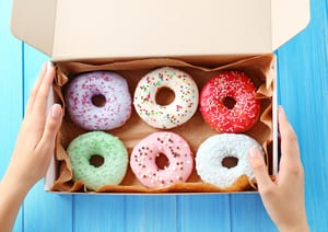 box of sprinkled donuts