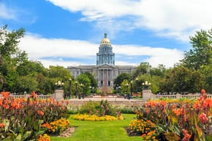 photo of the Denver State Capitol building with the greenery and garden on display