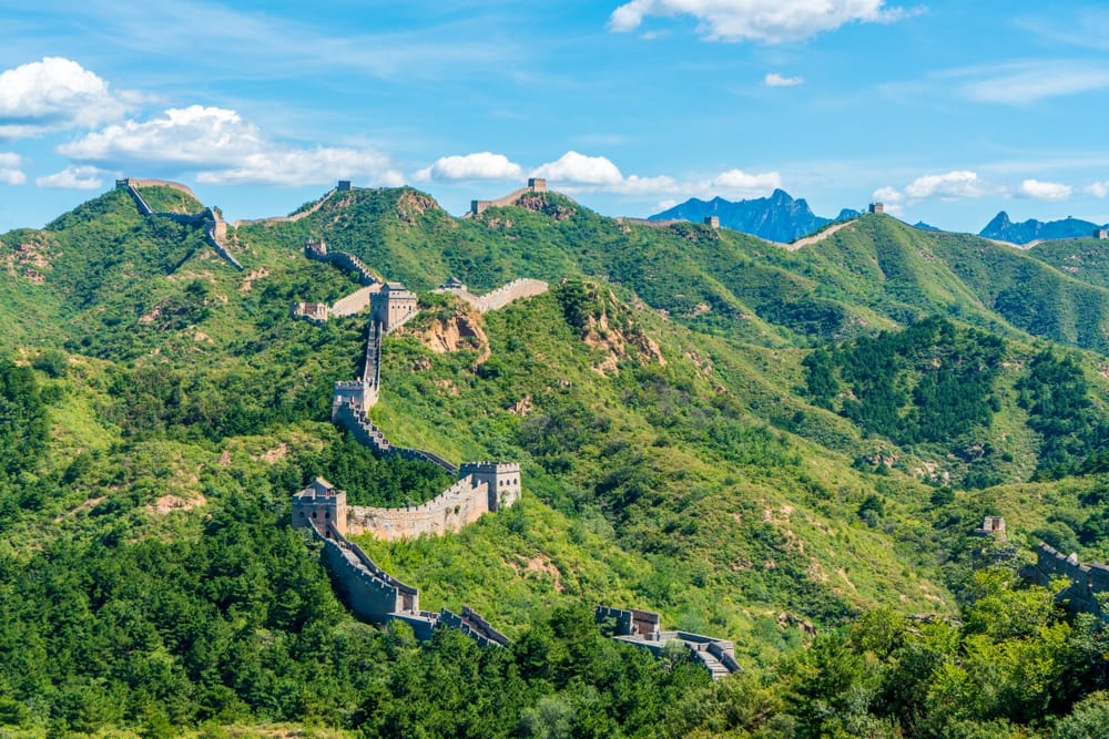 aerial shot of the great wall of china and the greenery that surrounds it, showing that the history of cannabis around the world started in china