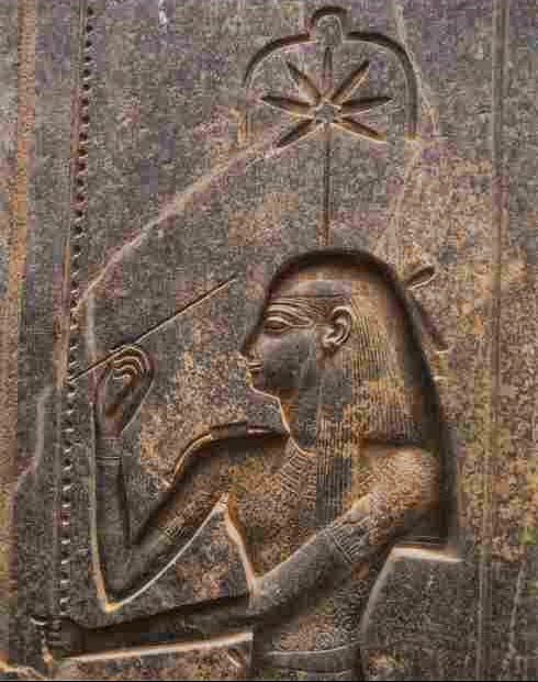 image of a wall carving of the ancient egypitan figure Seshat with her signature seven-pointed leaf above her head
