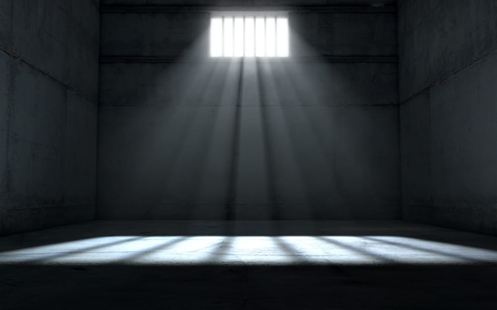 empty jail cell with small amount of light coming in