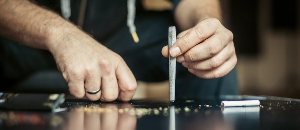 a person putting the finishing touches on a joint