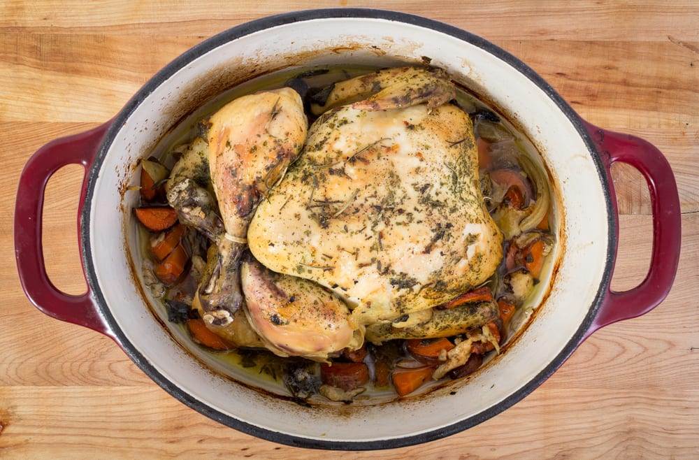 photo of herb-roasted chicken in a crock pot after it's done cooking, showing what your cannabis oil crock pot recipe could look like