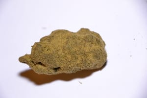 image of a marijuana moon rock with a white background