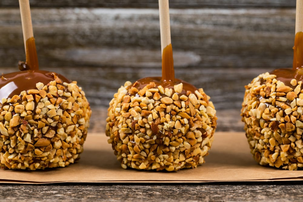 caramel apples covered in nuts for the perfect cold weather munchies