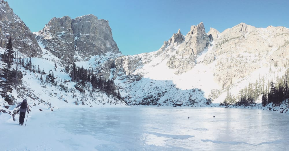 frozen lake in rocky mountain national park that's a perfect place to snowshoe in colorado