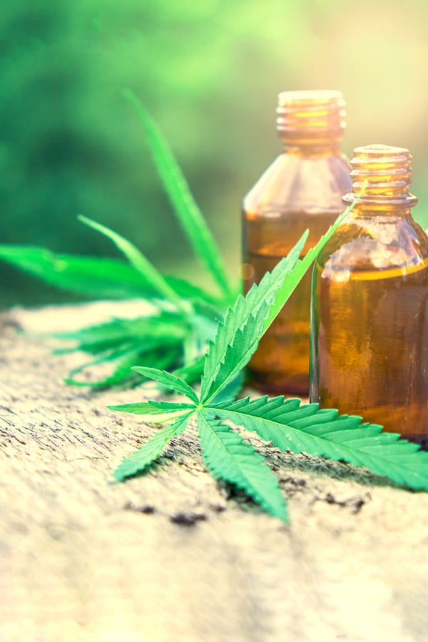 hemp leaves and cannabis oil that could be full-spectrum cbd