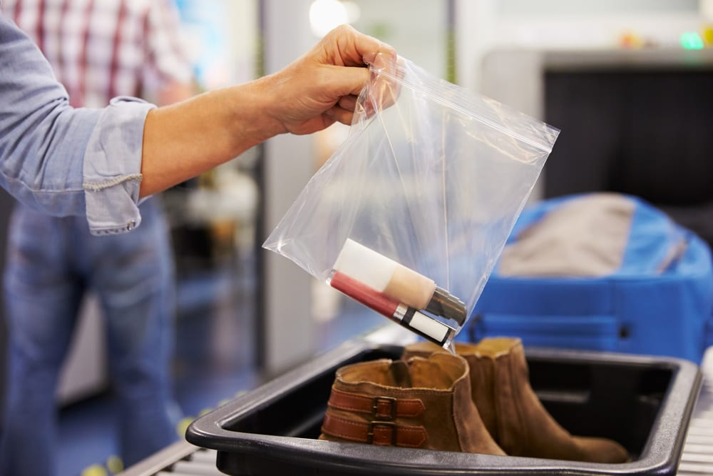 passenger taking liquids out at security at the airport