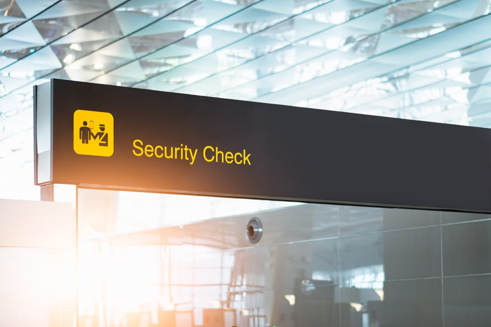security check sign at airport