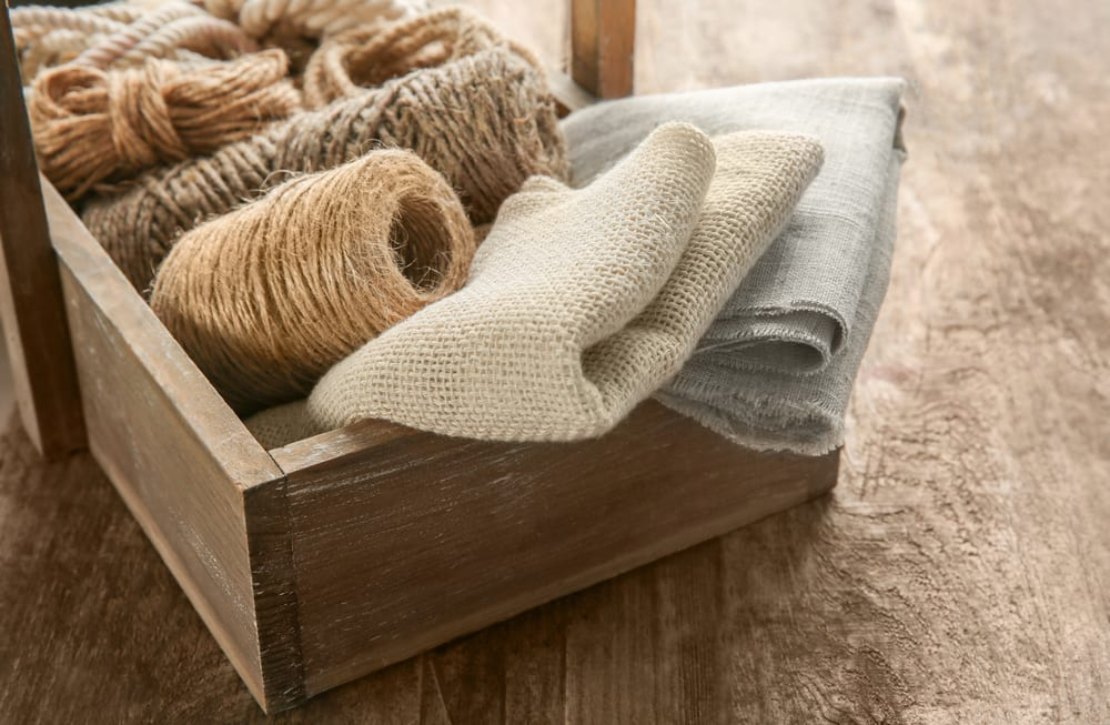 hemp rope and hemp fabric in a wooden basket
