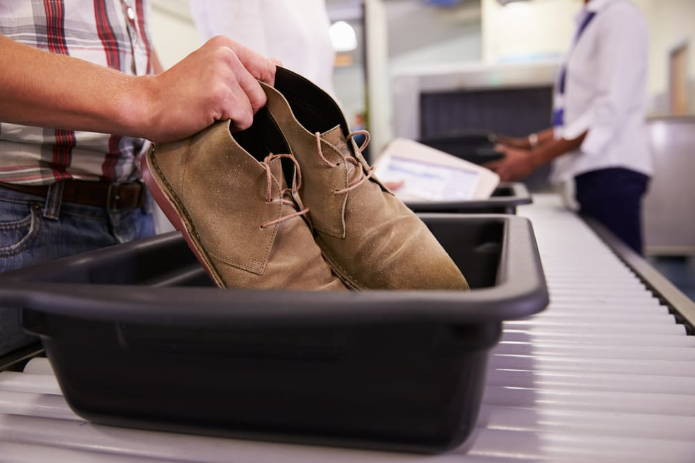 taking off shoes at airport security