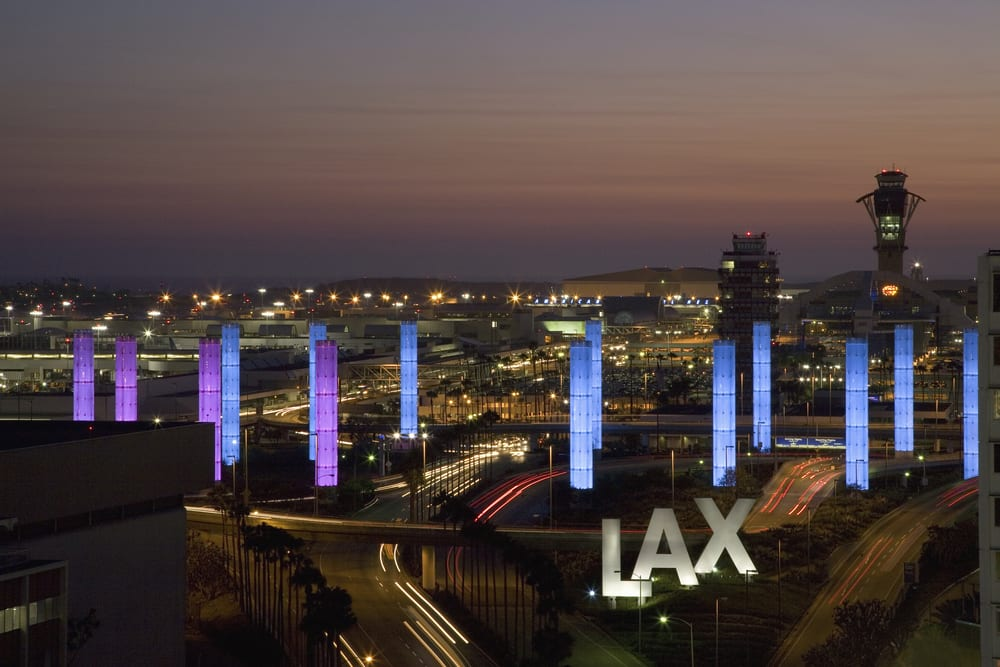 exterior of los angeles international airport at night, where flying with weed might be safe
