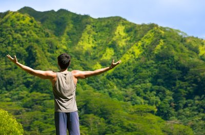 Man with Lifted Arms in Nature