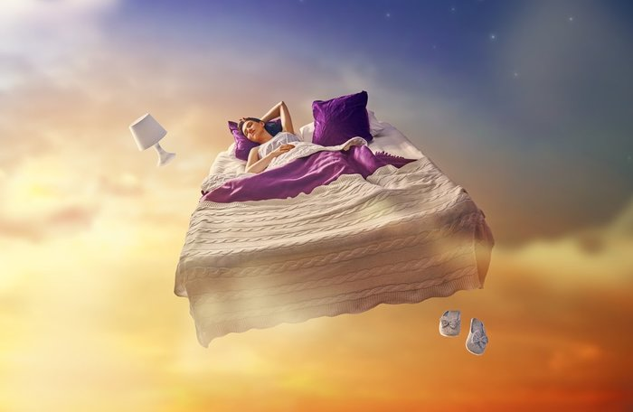 Woman Dreaming on Floating Bed