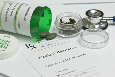 medical cannabis and doctor pad