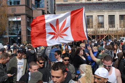 Canada marijuana laws approve recreational weed, Canada pot flag waves above crowd