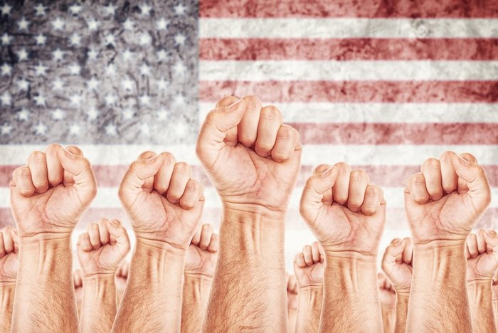 Fists in front of the American flag - Cannabis State of the Union