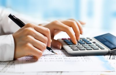 Accounting helps marijuana pay in the cannabis industry -- hand, pen and a calculator