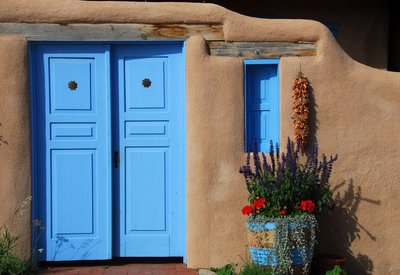New Mexico marijuana laws and an adobe house with blue doors