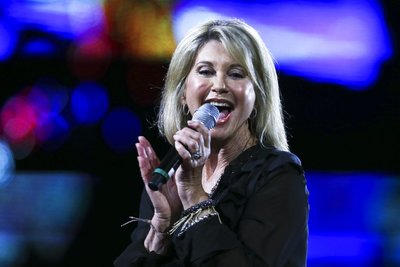 FILE - In this Feb. 23, 2017, file photo, Olivia Newton-John performs during the Viña del Mar International Song Festival at the Quinta Vergara in Viña del Mar, Chile. Newton-John said she has been diagnosed with cancer for the third time in three decades. The four-time Grammy winner, who will turn 70 on Sept. 26, told Australian news program