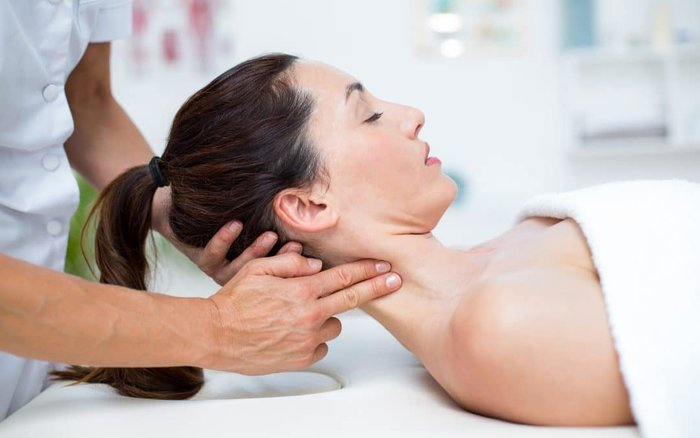photo of a woman getting a neck massage