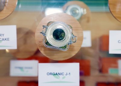 jar of marijuana flower in glass display at dispensary