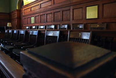photo of an empty jury box in a courthouse