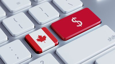 "image of the canadian flag replaced as a key on a keyboard with a red dollar sign on the ""enter"" key"