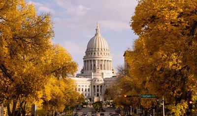 photo of the wisconsin state capitol in fall, showing that wisconsin is going to need to act on the positive response voters gave to the marijuana referendums