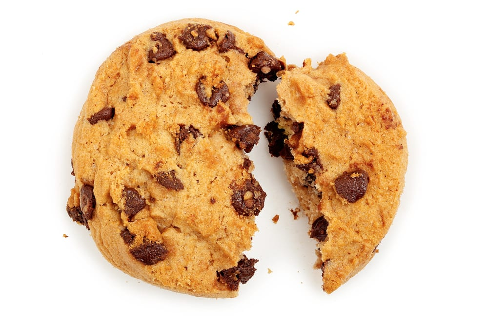 splitting a chocolate chip cookie