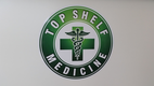 Top Shelf Medicine logo