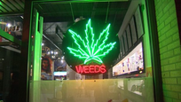 WEEDS - Montreal Rd logo